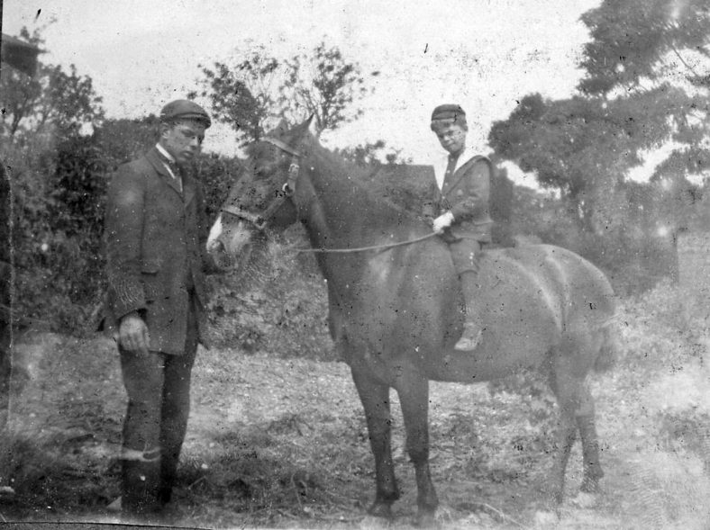 Man and boy with horse, probably Madge Family