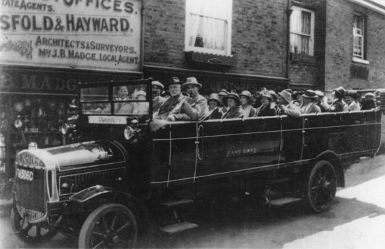 Charabanc outside Madge's Stores, Well Lane