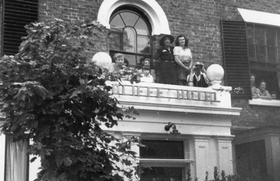 Watching wedding arrivals from the Cliffe Hotel porch roof. Undated