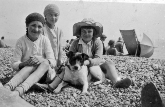 Photograph of 3 children on a beach, found during the demolition of Cliffe Place, Station Road