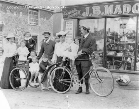 Unidentified family group outside J B Madge's shop, High Street. c1900 - 1910