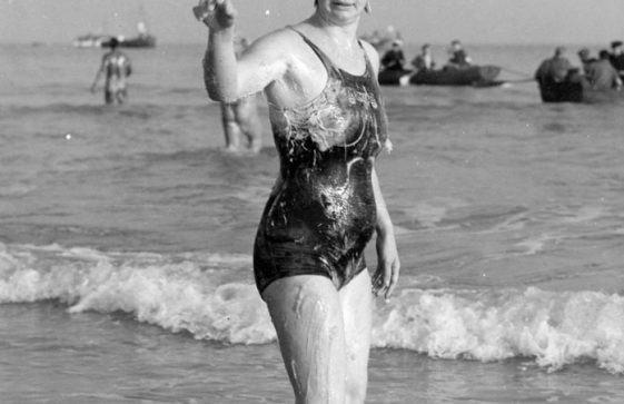 Brenda Fisher completing her Cross Channel swim and the celebrations afterwards.1954