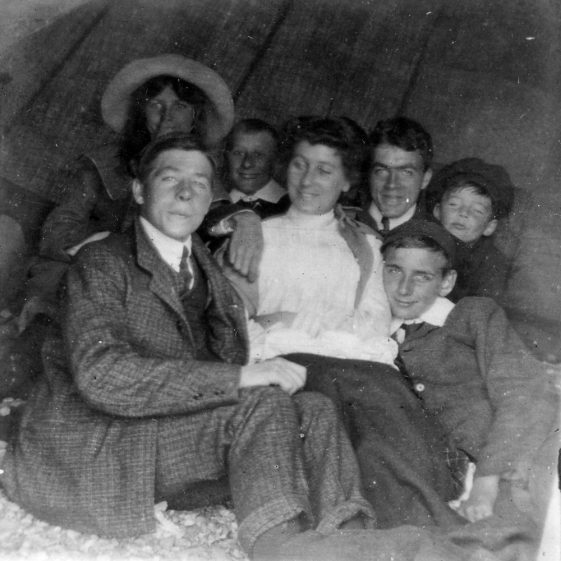 Young people on the beach. 1906