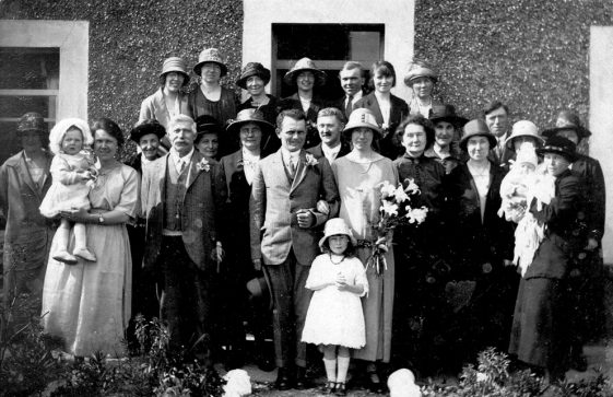 An unknown wedding group with Tom Clayson in the front row