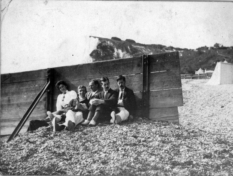 Beach scene by a break-water in the Bay. 1906