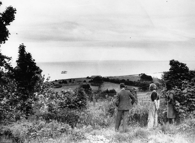 Mitchell family look across the Channel in wartime. 1942 | Unknown, but may have been a wartime photographic agency. Any information on this would be helpful