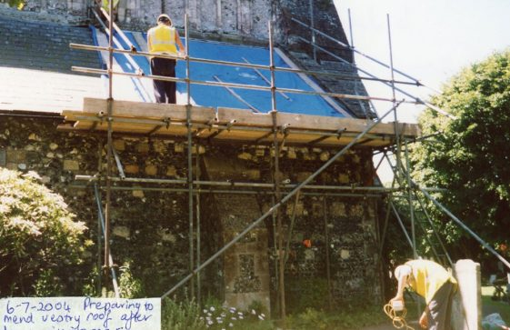 Work on the damaged vestry roof, north side of the church. 6 July 2004