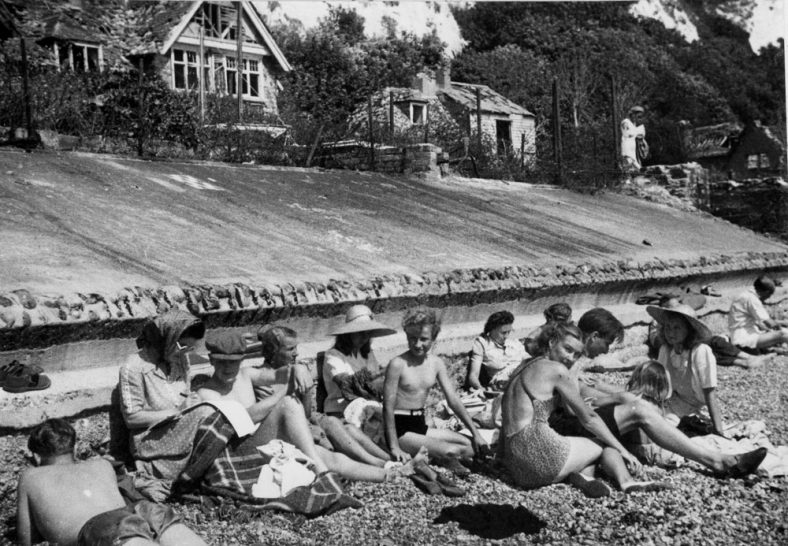 On St Margaret's beach with war damaged houses in the background. 1947
