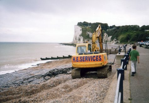 Mechanical digger removing redundant cable from St Margaret's beach. 31 August 2006