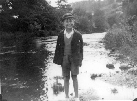 Young boy on bank of a river