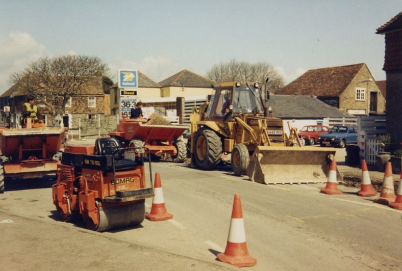 Road works, pile of equipment by Knoll Garage, High Street. 1986 [?]