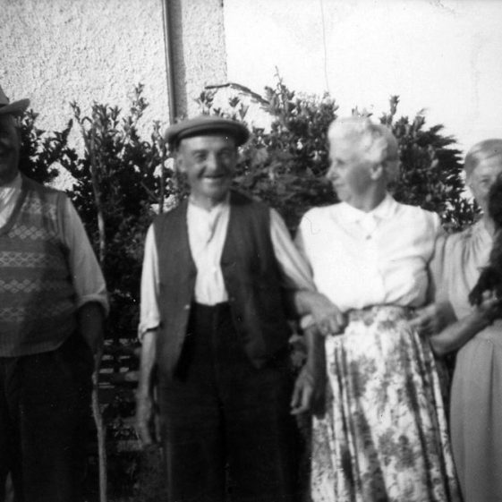 Annie Sharpe and her father with friends