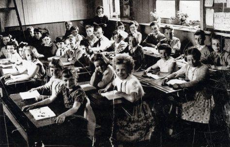 A class at their desks inside the National School. 1956