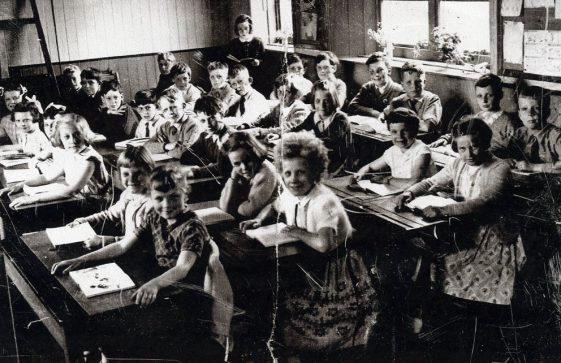 A class at their desks inside the National School. 1956
