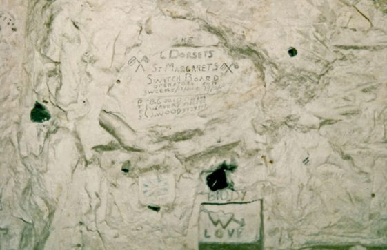 A series of 19 photograph showing wartime graffiti in the tunnels beneath The White House, St Margaret's Road