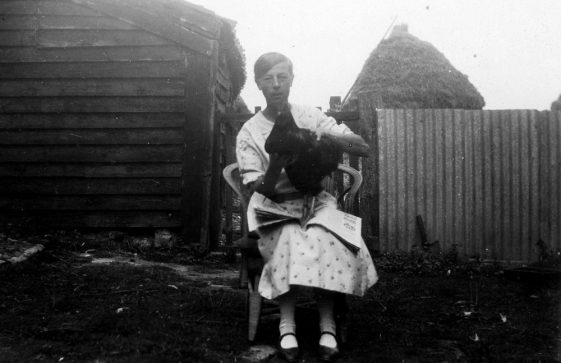 Annie Sharpe and a hen at Bockhill Farm
