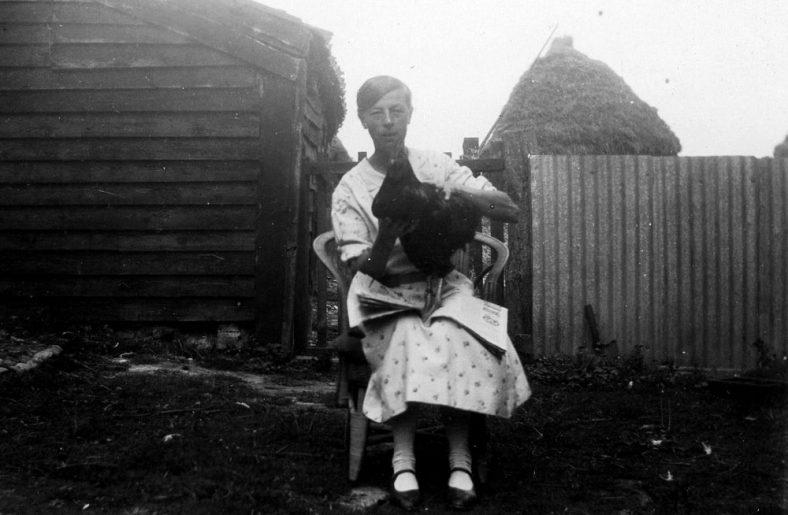 Annie Sharpe and a hen at Bockhill Farm