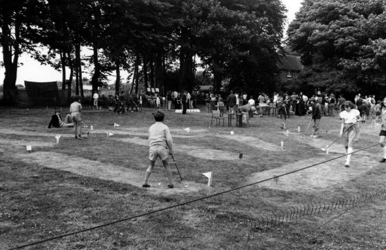 Children playing putting on the Glebe Field during the Village Fete. 1976