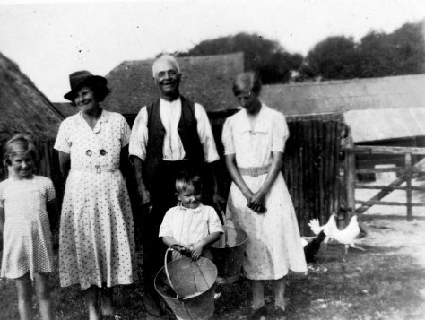 Annie Sharpe with her father, mother and two small children. 1938