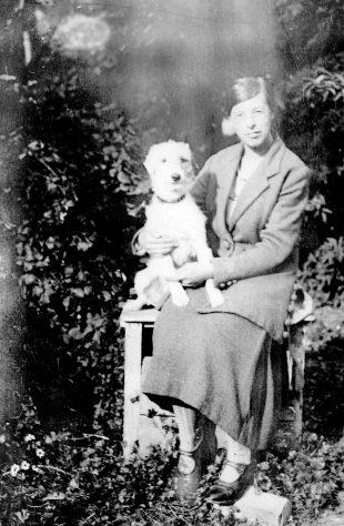 Annie Sharpe seated in a garden