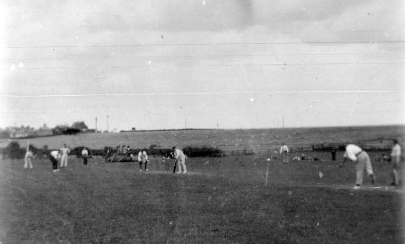 Captain Codd's XI playing cricket on Reach Meadow. 1906