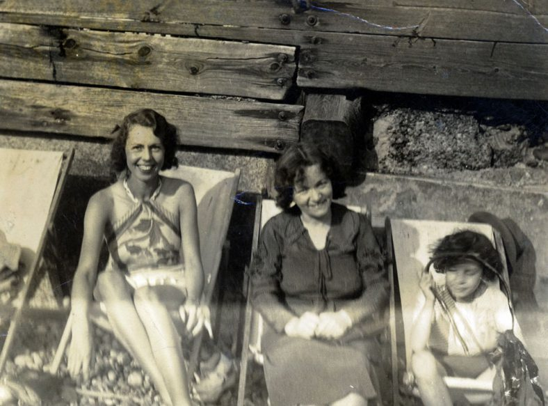 Molly Wyatt and two others sitting on the beach in St Margaret's Bay. 1930s