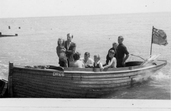 Jim Atkins jun's boat and day trippers in the Bay. Late 1940s