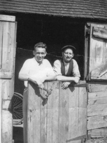 Douglas Stanford, Blacksmith with an unidentified man at The Forge, Kingsdown Road. c1930