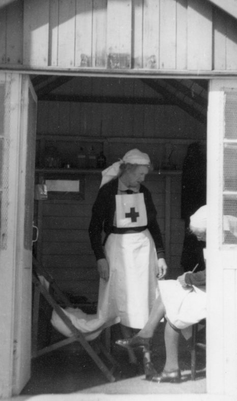 Red Cross workers in hut. Date unknown