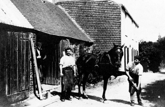 Wallace Newman Charlie Burden and George Chapman outside The Forge in Kingsdown Road. 1905