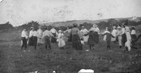 Group of ladies and children dancing in a field c.1905