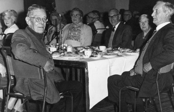 Group of elderly people at a meal (possibly in the Parish Hall). Date unknown