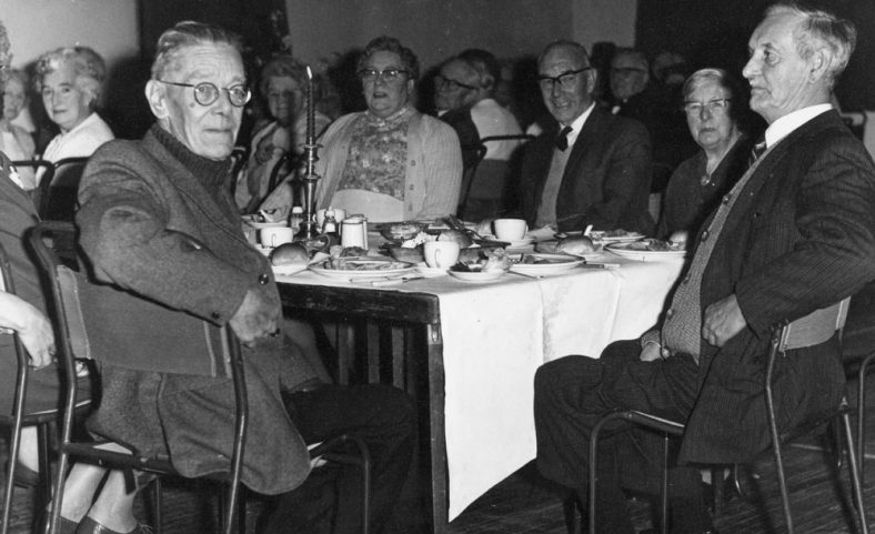 Group of elderly people at at meal (possibly Parish Hall). Date unknown
