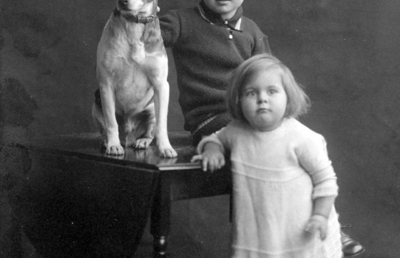 Studio portraits of young children with a dog