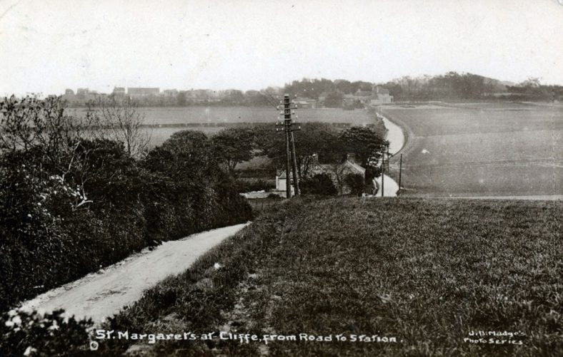 A view from the top of Station Road towards the village. postmark 1950