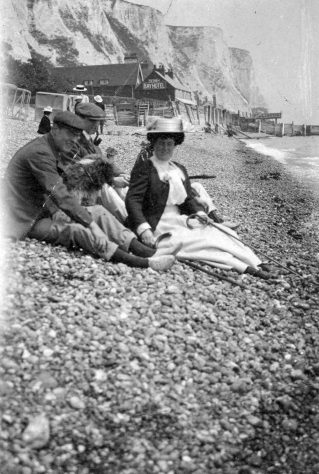 Sitting on the beach in St Margaret's Bay. c1900