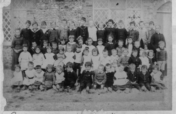 Pupils and teacher outside the National School, Kingsdown Road. c1910