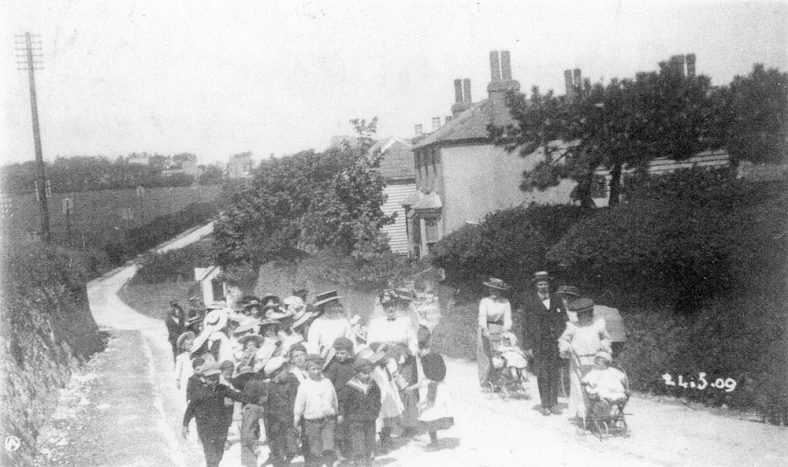 Marching up Sea Street to the Coastguard Station on Empire Day. 24th May 1909