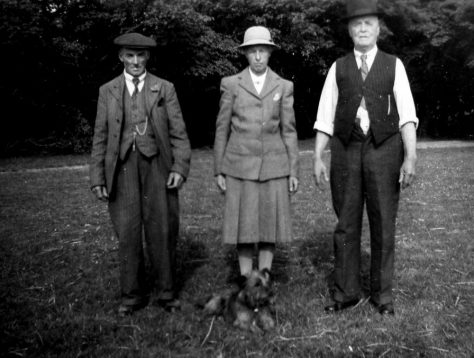 Annie Sharpe with her father, another man and a dog.