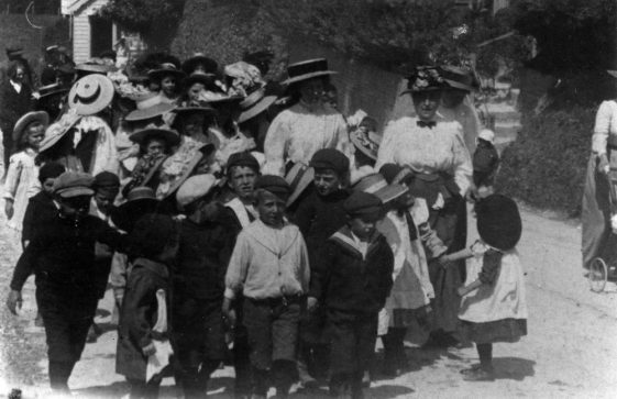 Children from St Margarte's school marching to the Coastguard Station Bay Hill to celebrate Empire Day' 1909