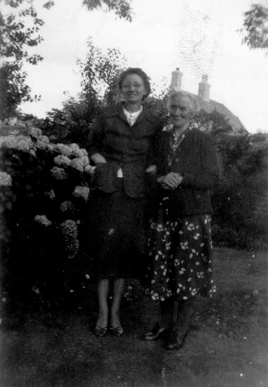 Alice Newman and Mildred Scarfe in the garden at Street Farm Garage