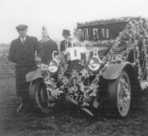 Eric Finnis with his car decorated for the King George VI Coronation celebrations.